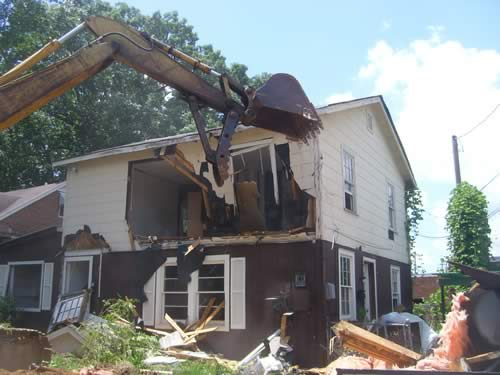 Charlotte, NC demolition service demolishing a house